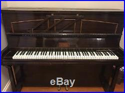 Antique Upright Piano Originally from England. Nice piece of furniture too