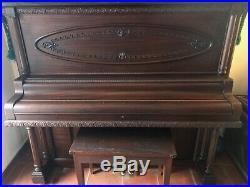 Antique upright piano