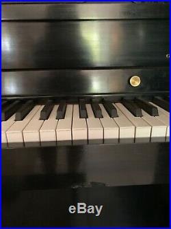 Baldwin Upright Concert Grand Piano