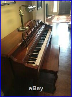 Baldwin upright piano, bench and lamp, gently used condition