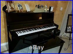 Black lacquer samick up right piano