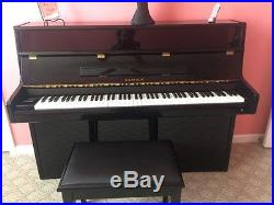Black lacquer samick up right piano with matching bench slightly used 1 owner