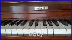 Grand console piano