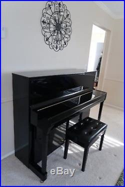 Immaculate, black upright Kawai piano