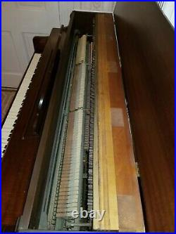 Jacobs Brothers piano with a bench excellent condition