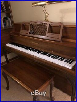 Kawai upright piano & bench. Great condition. 56longx25deepx39high $395 or B. O