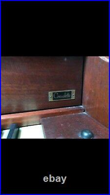 Kimball upright piano including bench and sheet music