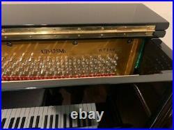 Pearl river 49 upright piano