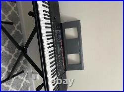 Piano yamaha used, color black and in great condition. Piano was barely used