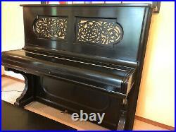 Steinway upright grand piano