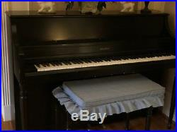 Upright Piano with upholstered detached pillow and bench. Julius Bauer brand