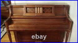 Wurlitzer upright piano (1987) Cherry wood finish. Condition is Used. $780.00