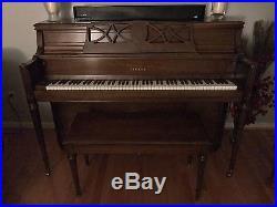 Yamaha upright piano, walnut finish, great condition, with matching bench, M203