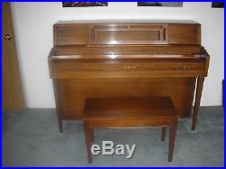 Yamaha upright piano with matching bench local pickup